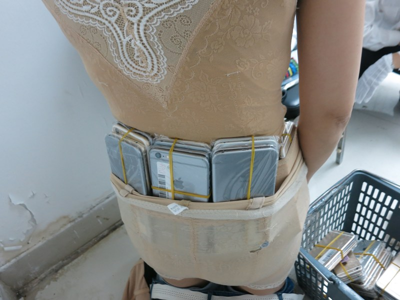 Smuggler Got Caught With 102 iPhones At The Hong Kong Airport Border Tucked Into Her Corset
